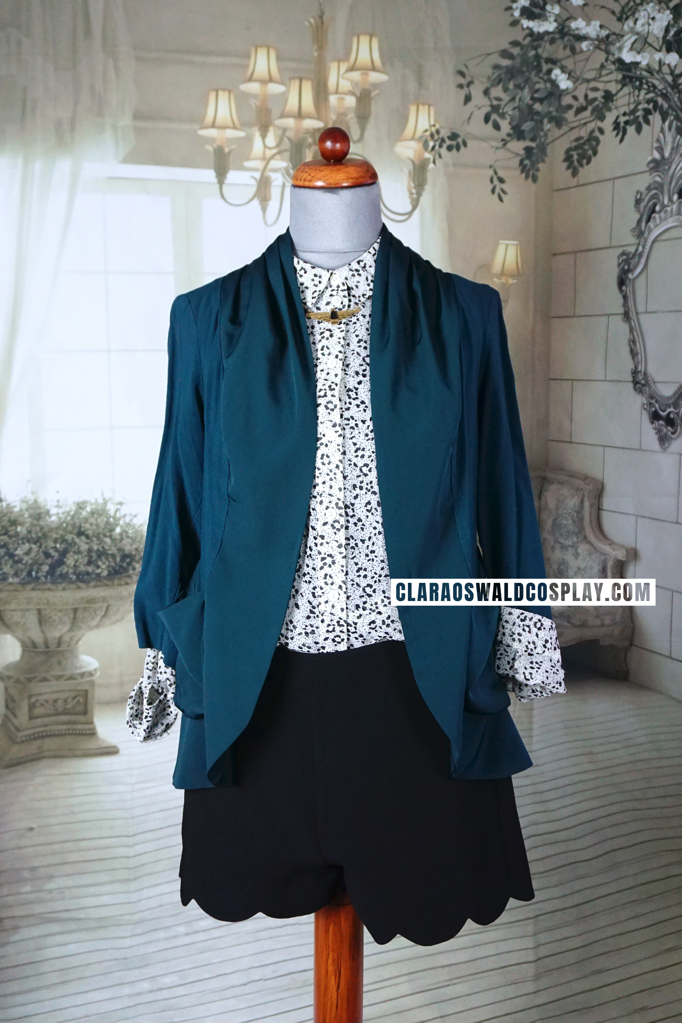 The second Bells of Saint John outfit worn by Clara Oswald featuring the Urban Outfitters Sparkle & Fade Animal Print Blouse and Kimichi Blue Cardigan in green