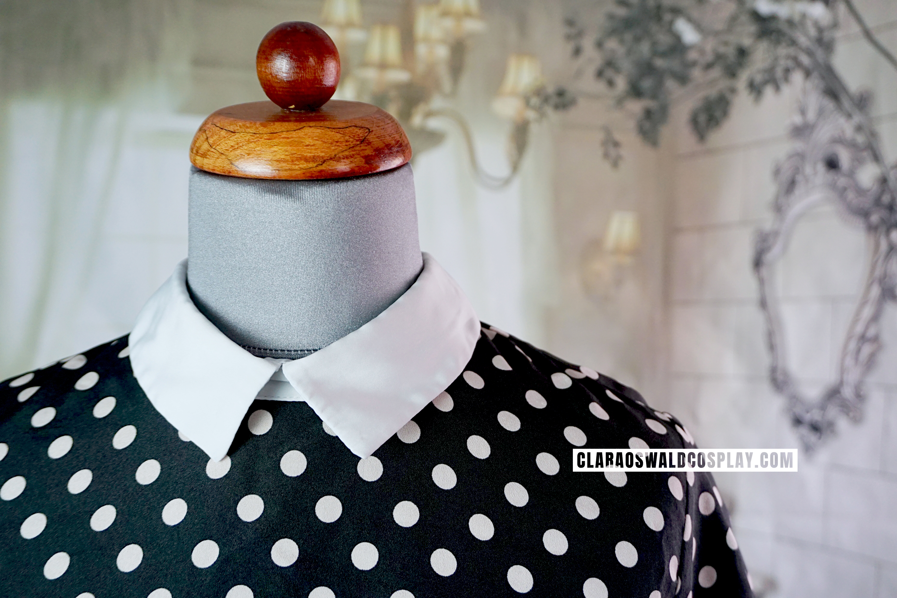 A close-up of the collar of the underrated River Island Polka Dot Blouse.