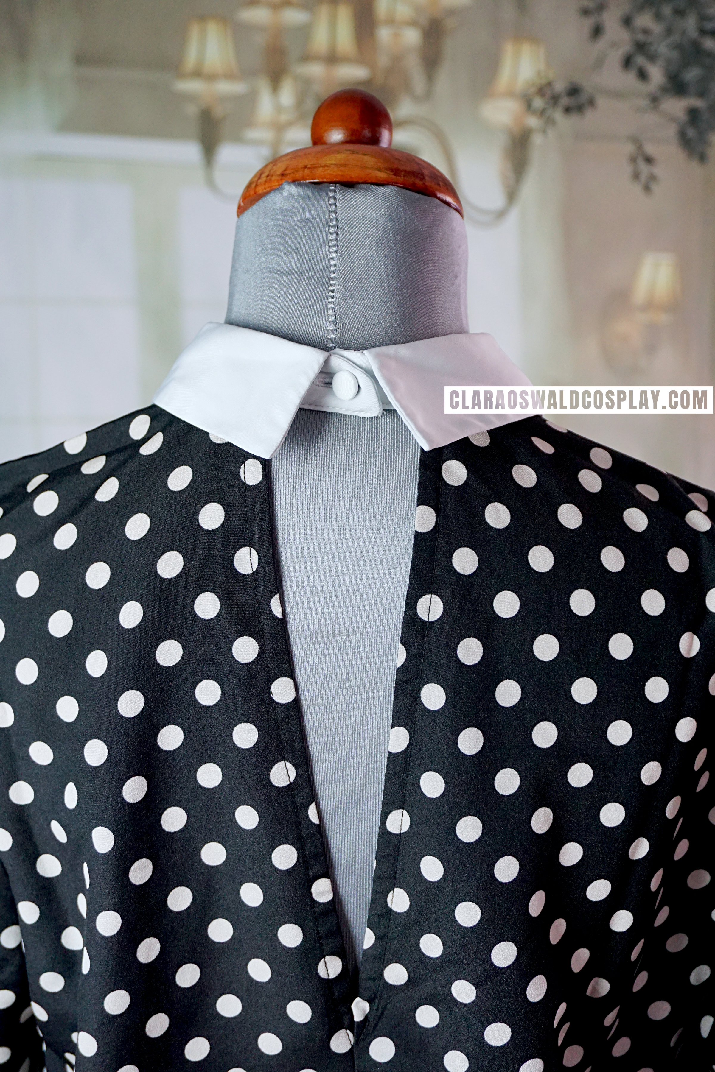 The River Island Polka Dot Blouse closes with a simple button in the back.