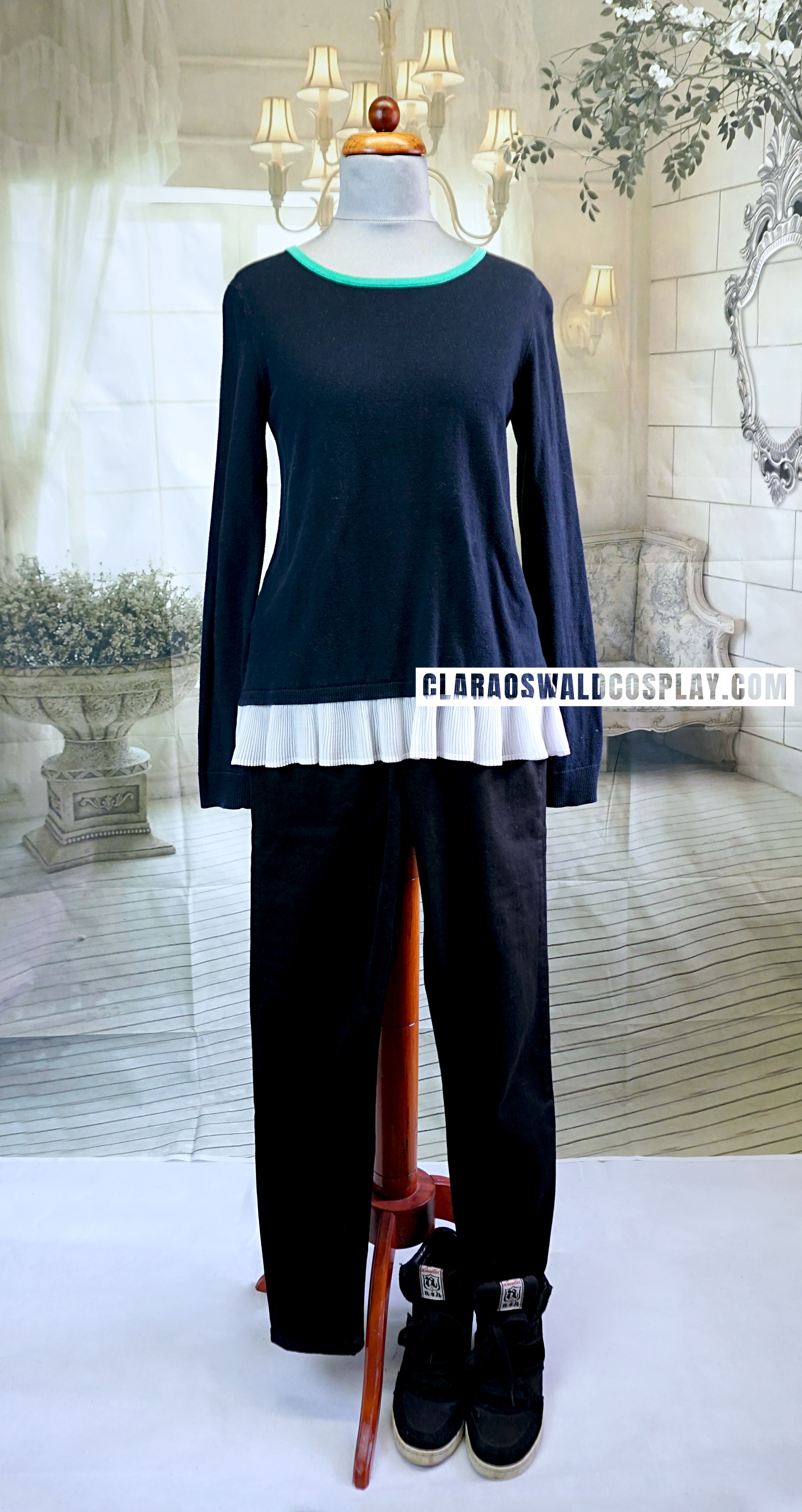 The whole outfit worn by Clara Oswald in the opening scene of Face the Raven. It consists of the Claudie Pierlot Frill Jumper, ASH Cool Wedges and black jeans.