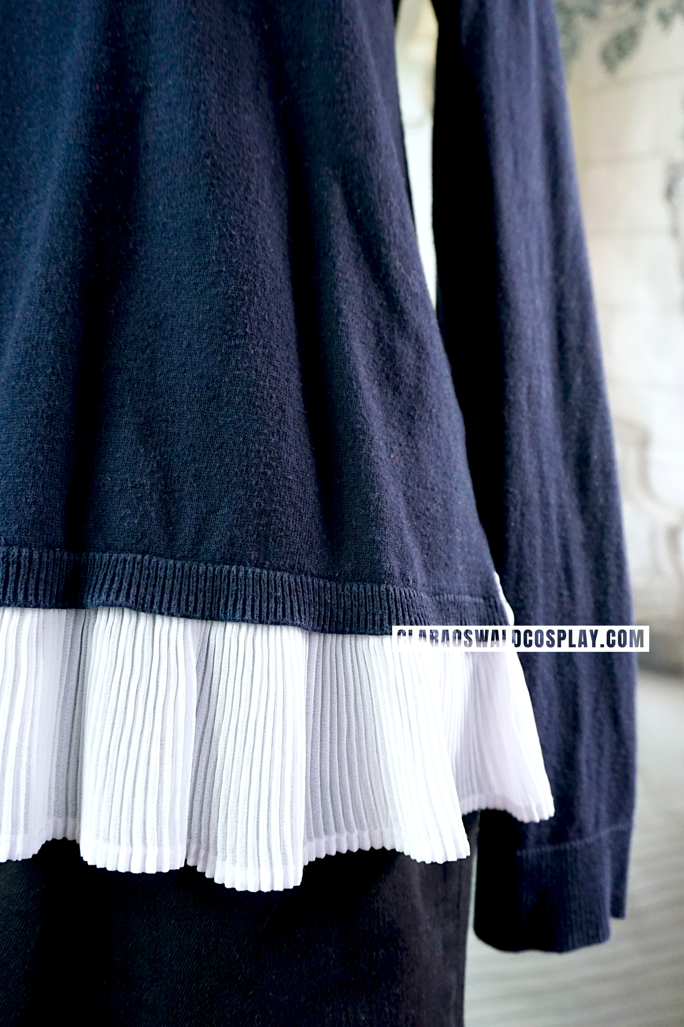 The frill part spices up the otherwise simple jumper.