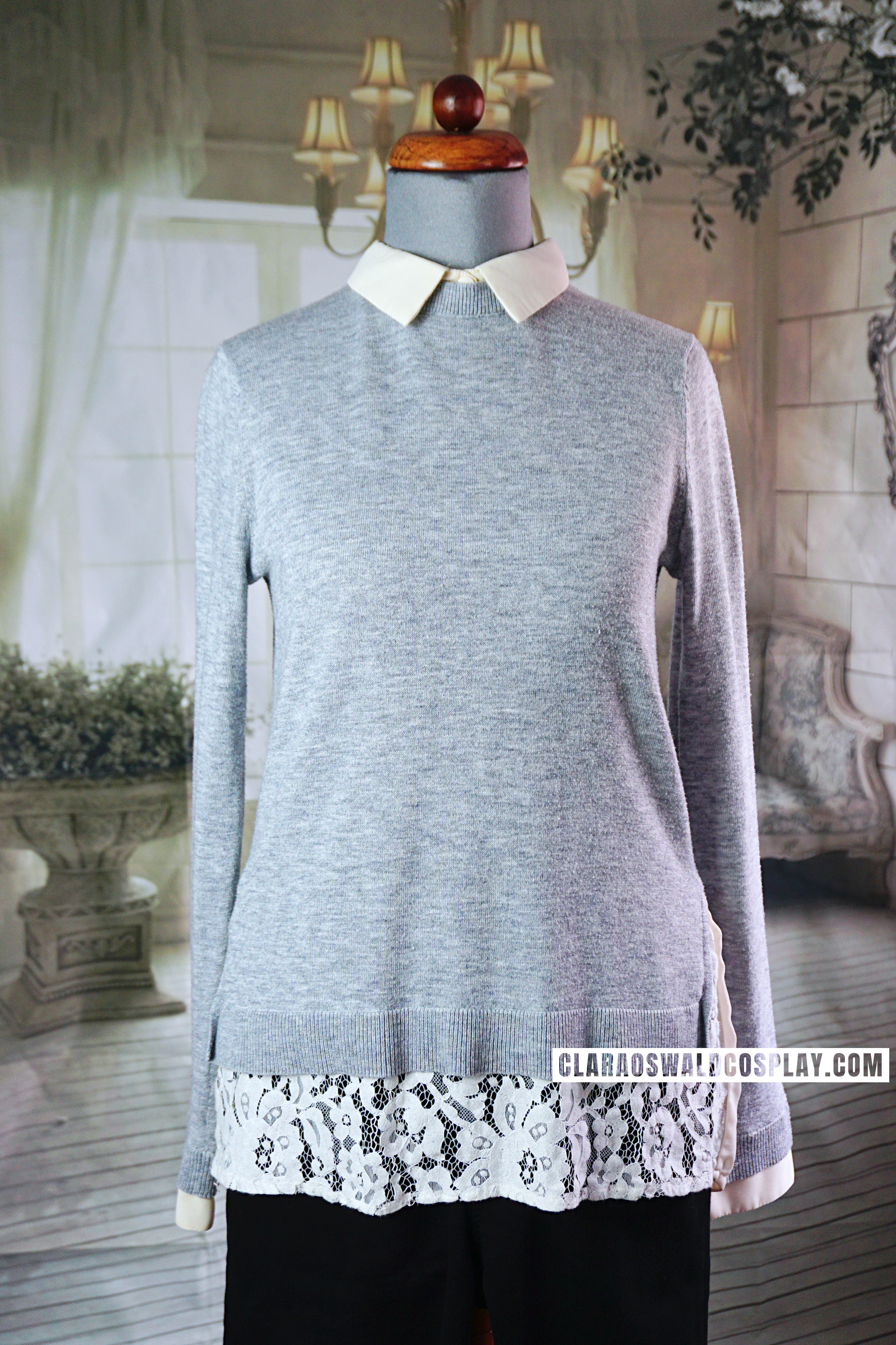 A close-up of the Topshop Hybrid Jumper worn by Clara Oswald