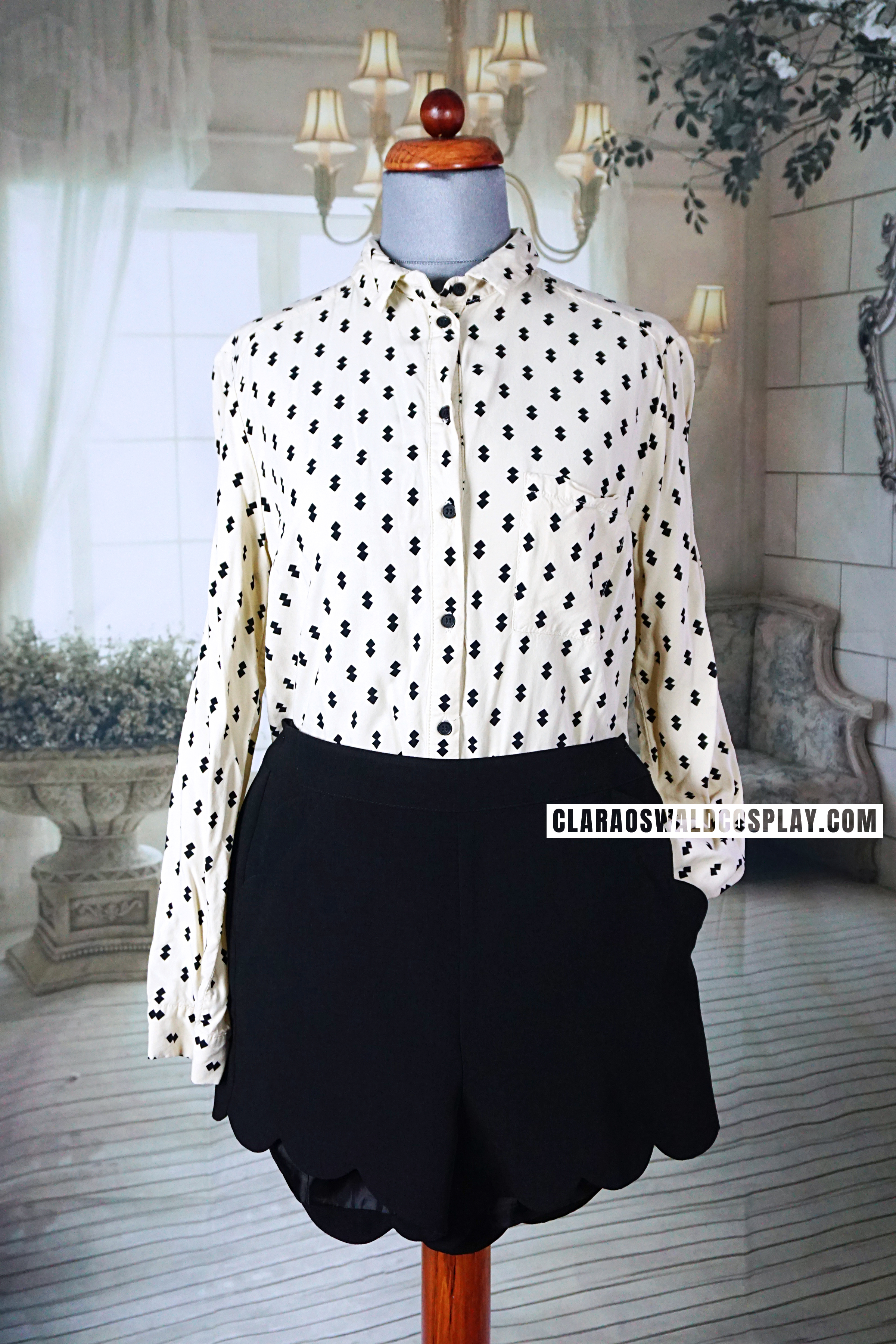 Clara Oswald's outfit from The Caretaker featuring the Topshop Diamond Print Blouse and Topshop Scallop Shorts