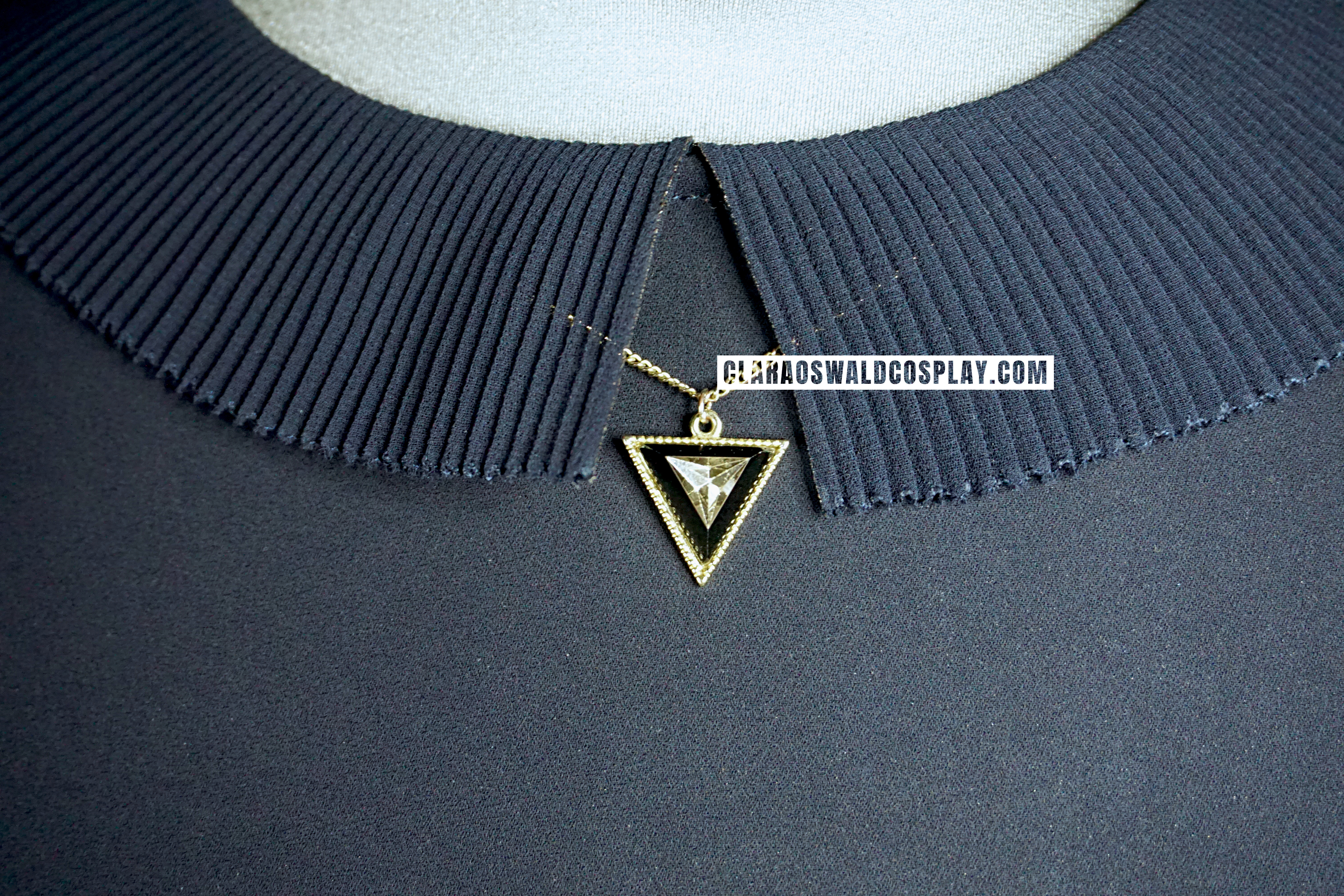 The Topshop / ASOS / River Island / H&M Triangle Necklace worn by Clara Oswald in Sleep No More