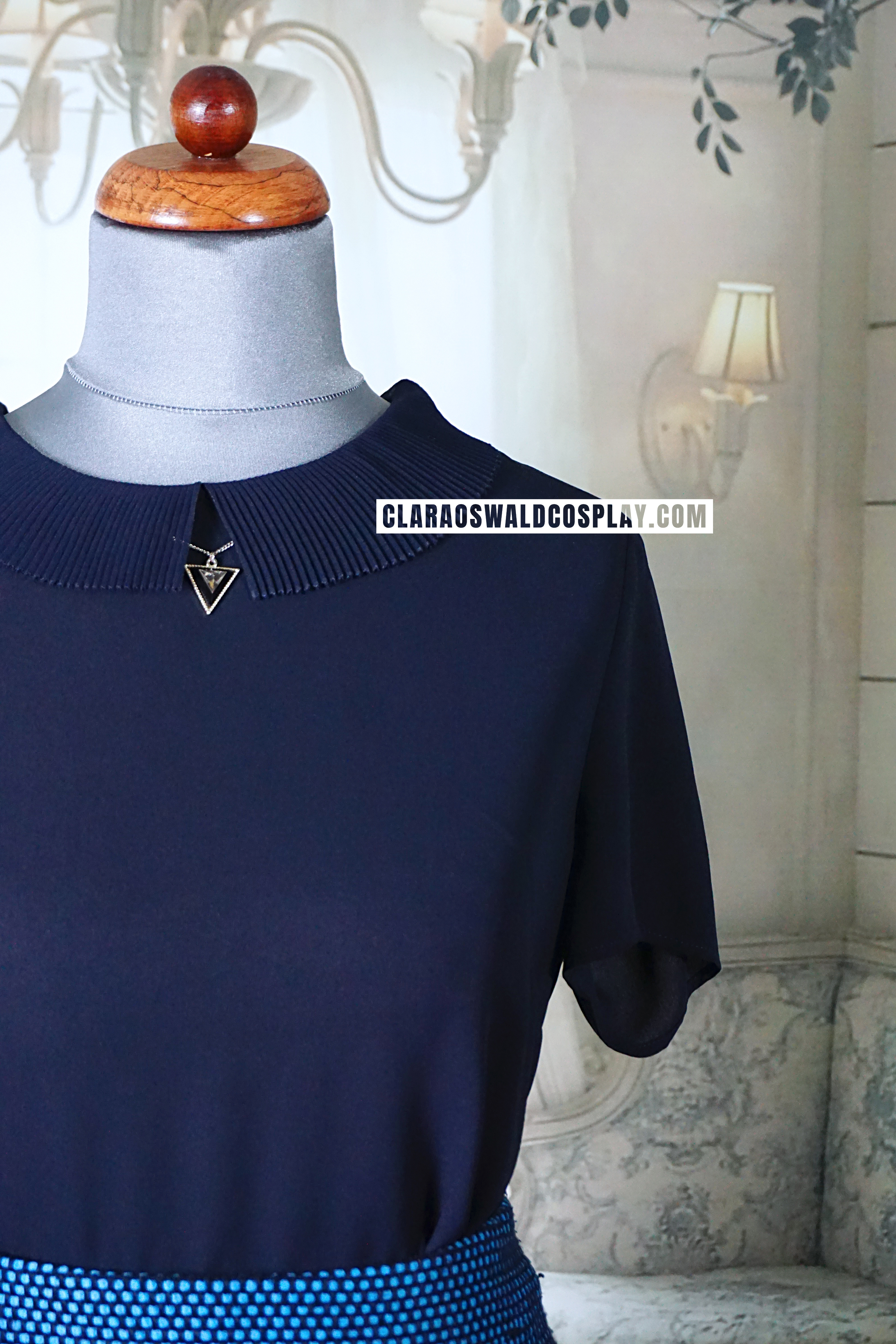 A closer look at the collar of Clara Oswald's Claudie Pierlot Brooklyn Top