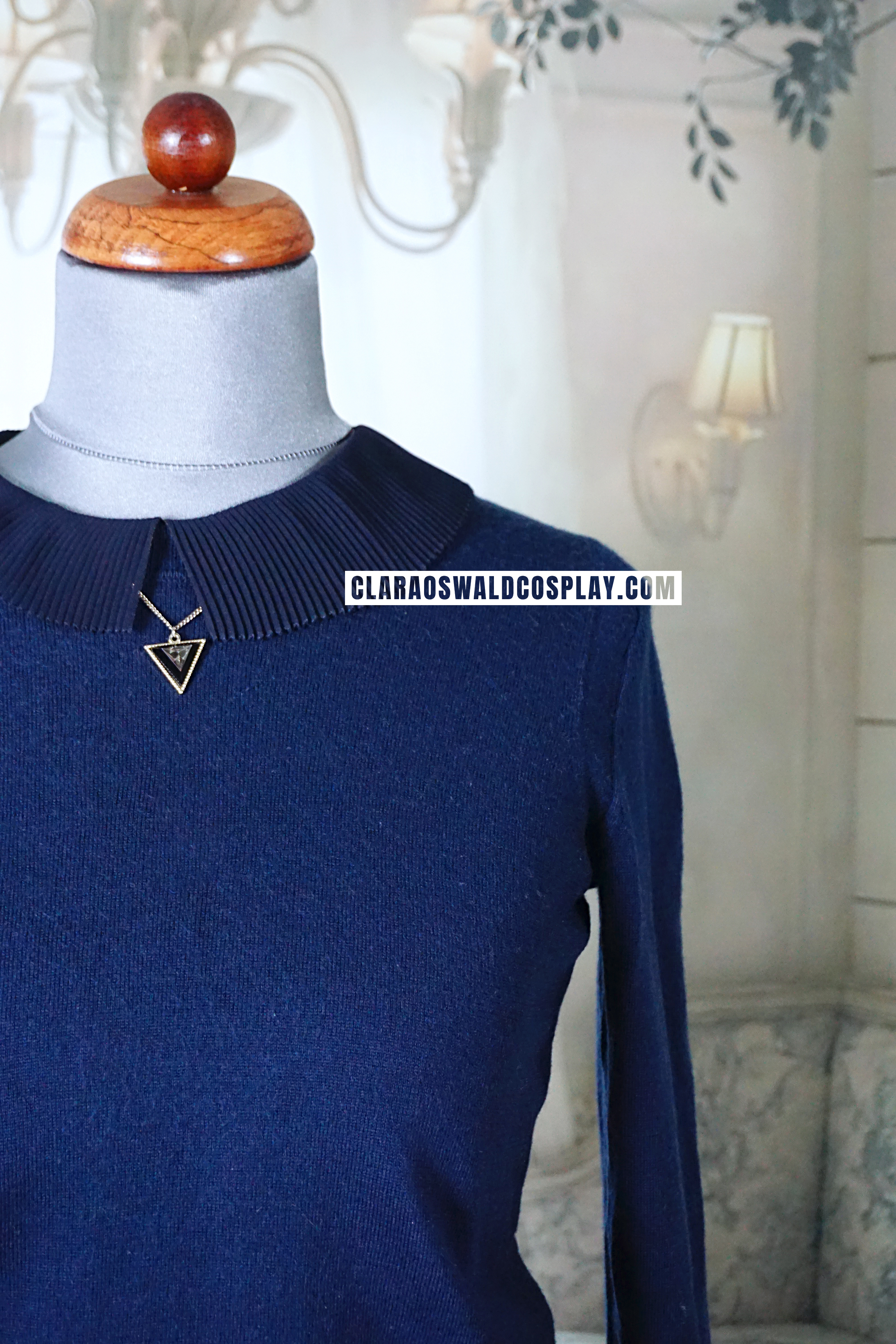 The Triangle Necklace is worn under the collar of the Claudie Pierlot Brooklyn Blouse and on top of the GAP Merino Jumper