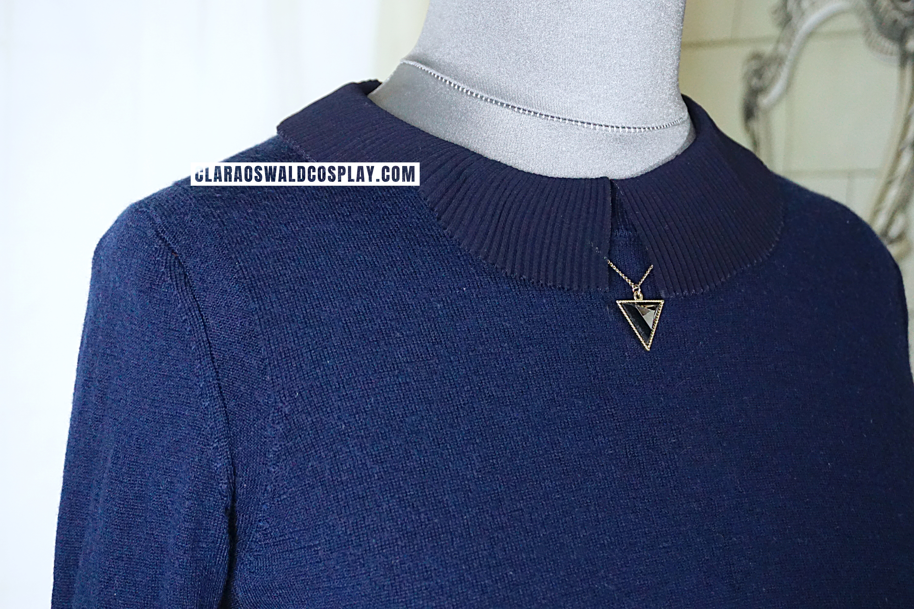 The GAP Merino Jumper in Navy can be identified by the sleeves
