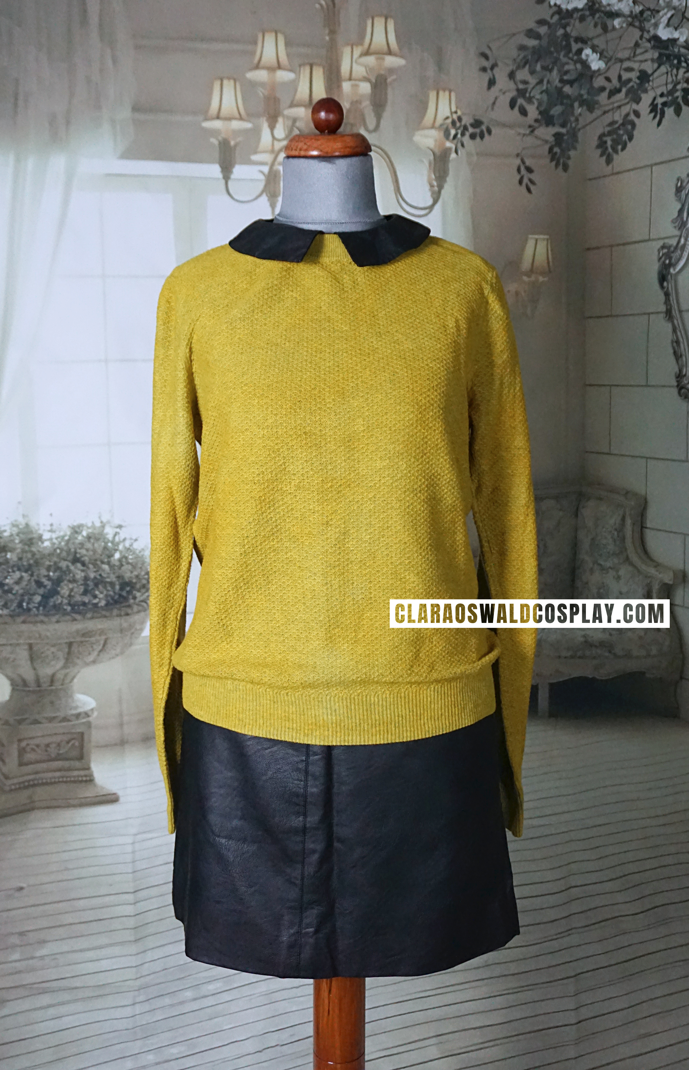 Clara Oswald's second Time of the Doctor outfit featuring the Topshop A-Line Leather Skirt (alt) and Oasis Yellow Faux Leather Collar Jumper