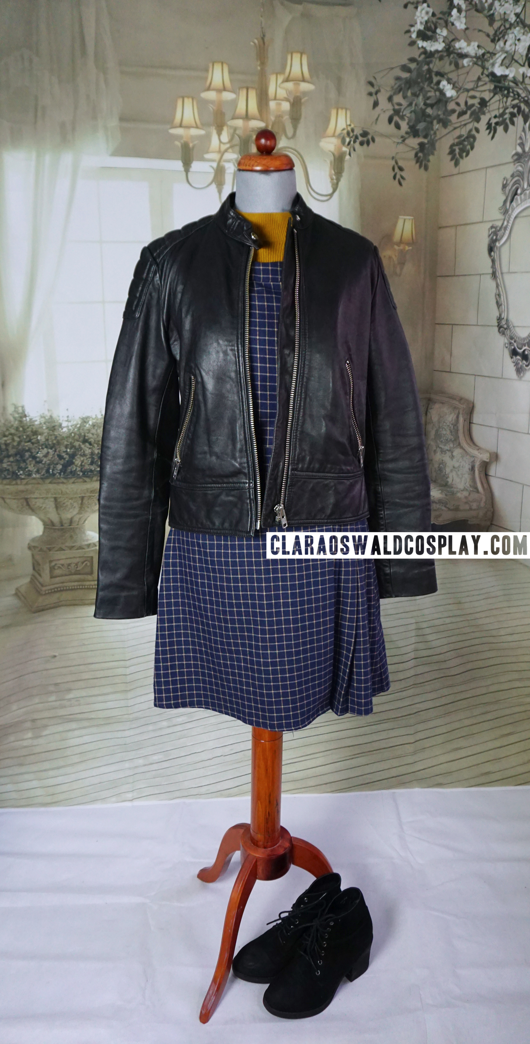 Clara Oswald's Under the Lake / Before the Flood outfit featuring the &Other Stories Leather Jacket, Miss Patina Primrose Pinafore and Topshop Mustard Crop Jumper