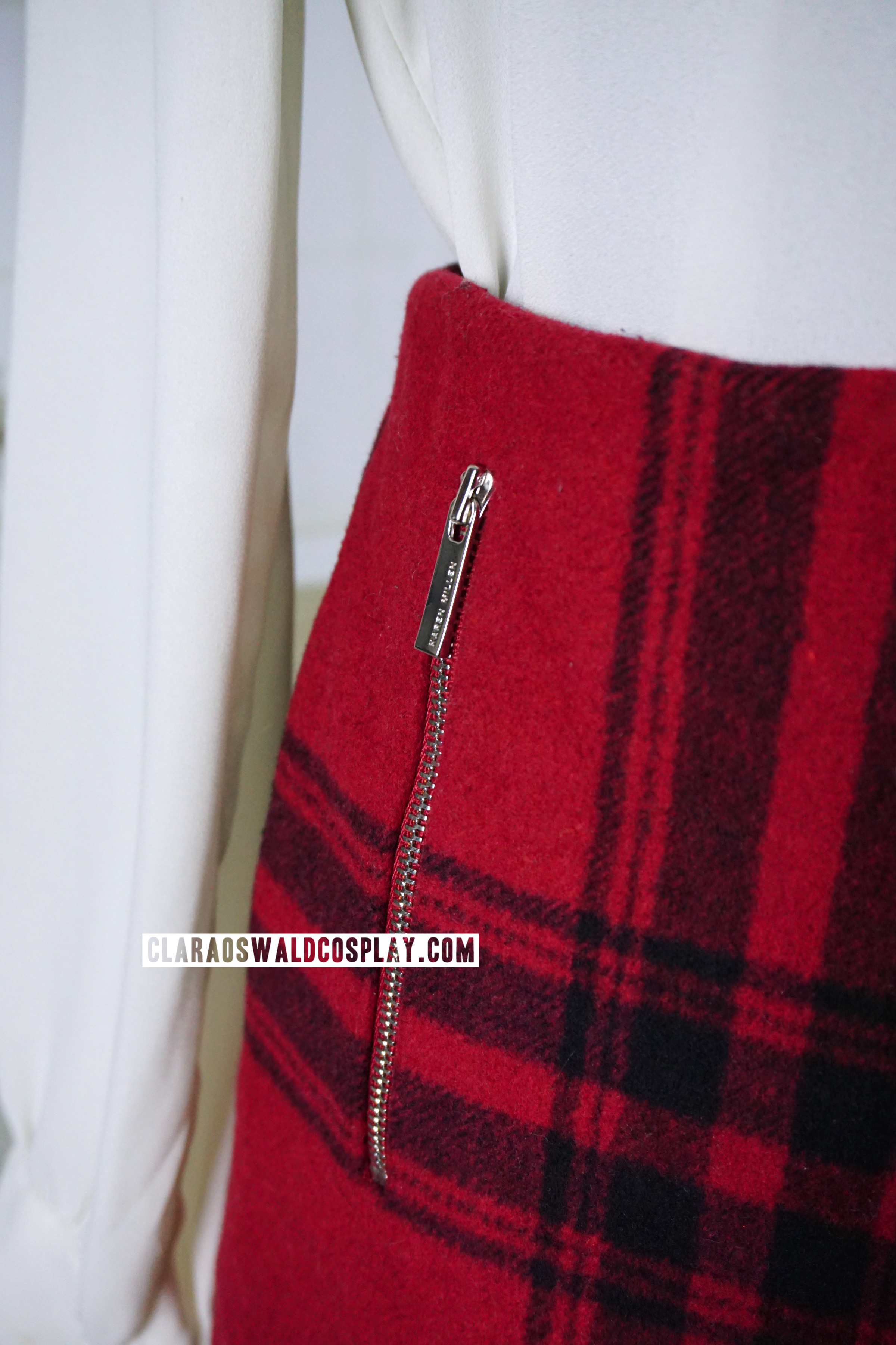 Clara Oswald's Karen Millen Masculine Check Skirt comes with a practical pocket that can be zipped up