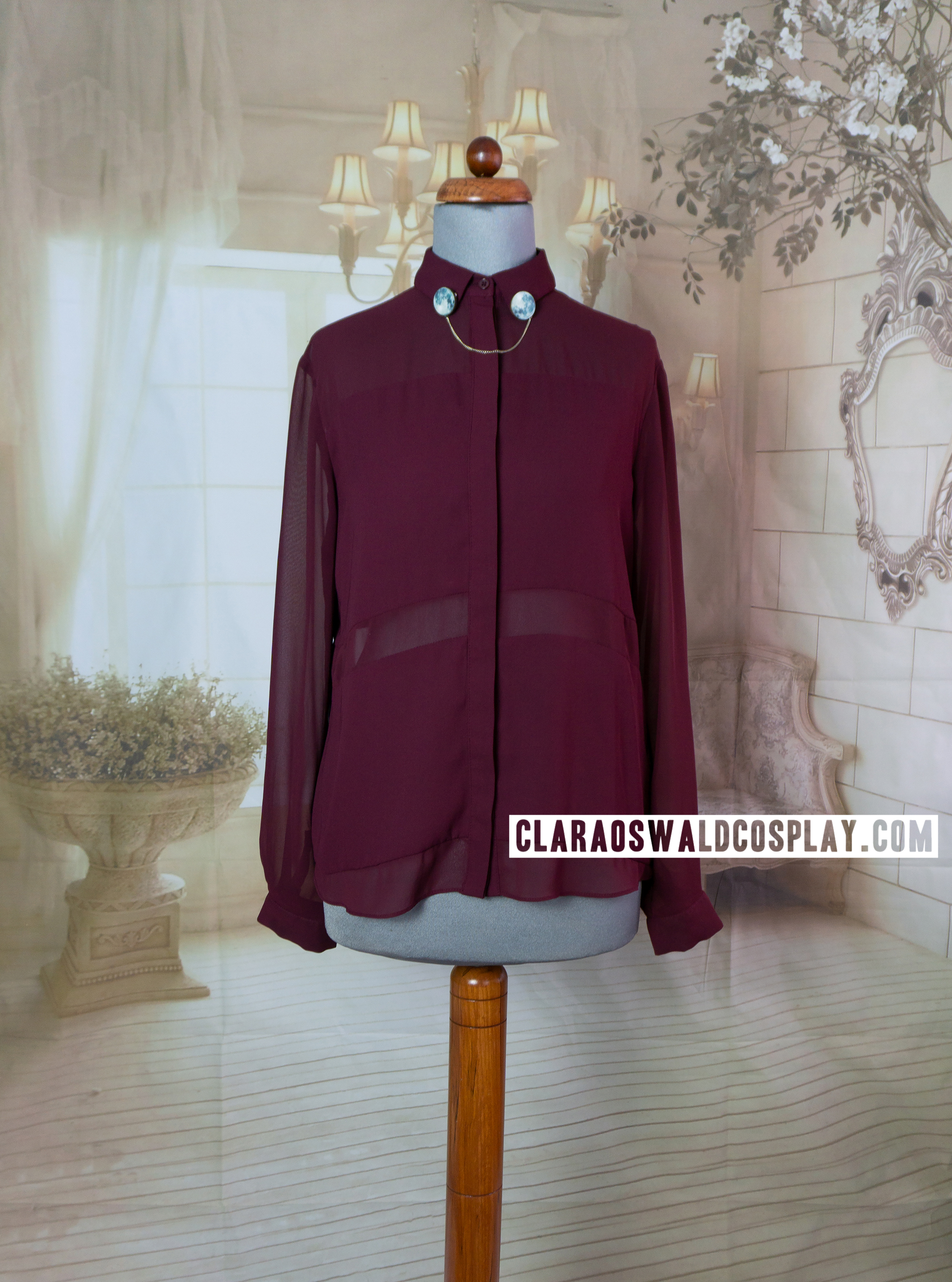 Clara Oswald's Topshop Burgundy Multi-Panel Blouse has two panels even though the lower one is usually hidden under the skirt