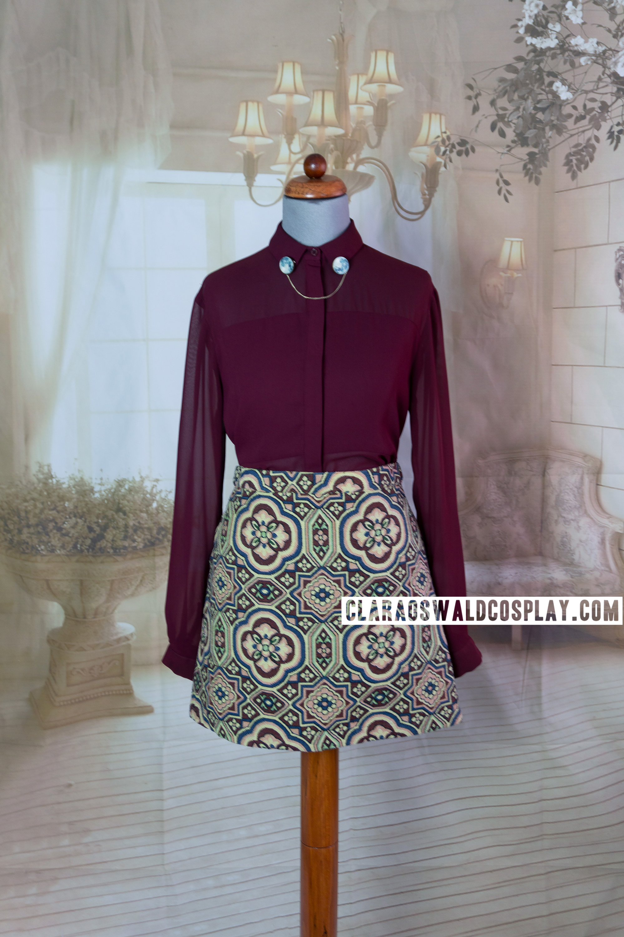 Clara Oswald's The Caretaker outfit featuring the Topshop A-Line Tapestry Skirt and Topshop Burgundy Multi-Panel Blouse